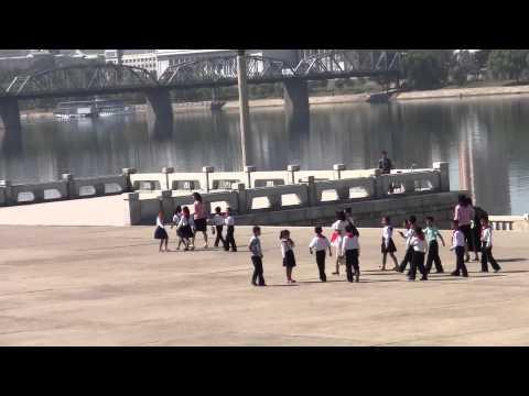 Pyongyang North Korea children near the Juche Tower & Taedong River