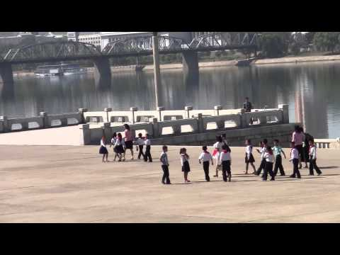 Pyongyang North Korea children near the Juche Tower & Taedong River