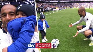 Lucas Moura celebrates with his baby son after scoring a hat-trick against Huddersfield