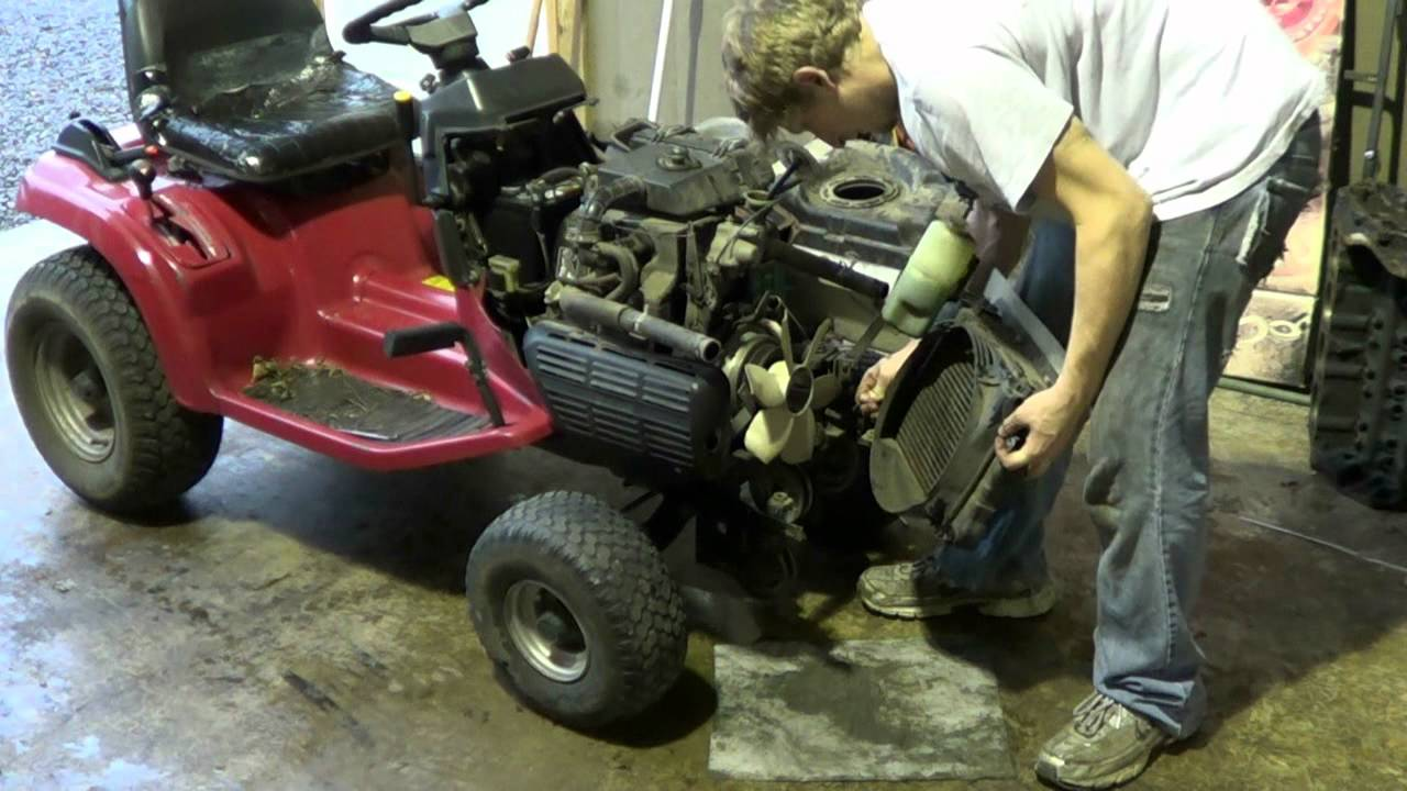 Working on the Honda tractor's pto clutch on