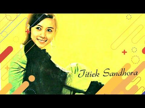 Titiek Sandhora - Potong Padi | Doovi