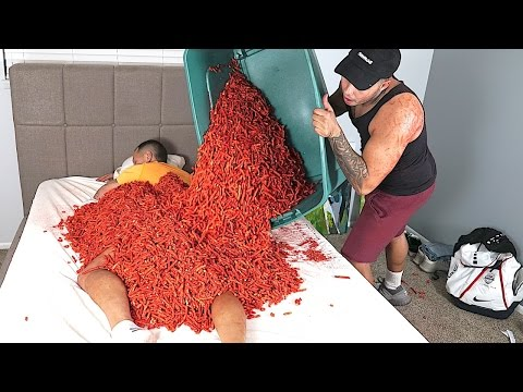 HOT CHEETOS AND TAKIS CHALLENGE PRANK ON BIG BROTHER!!! 100 + POUNDS!!!