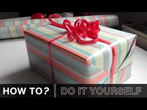 geschenkschleife basteln mit papier f r geschenke diy doovi. Black Bedroom Furniture Sets. Home Design Ideas