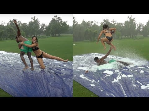 SLIP N SLIDE TACKLE FOOTBALL vs MY GIRLFRIEND (SHE SAQUON BARKLEY HURDLED ME)