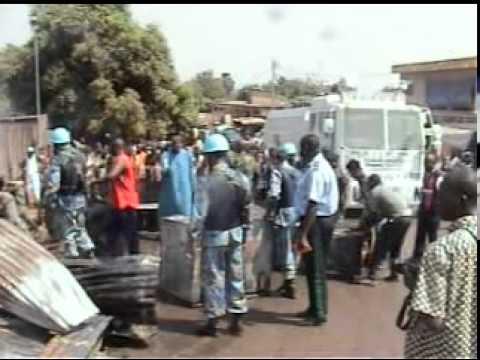 Bangladesh police in Peace Keeping Mission extinguishing fire in Bouake Market. Ivory Coast.