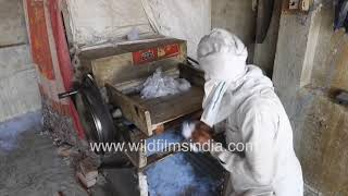 Cotton ginning with remote desi machine at small scale factory in North India