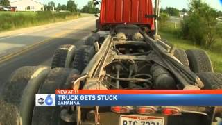 Stuck Truck: Dump Truck Bed Wedged Under Overpass