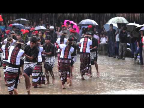 Rainy day dance in Mizoram: Indian boys and girls dance together
