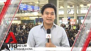 Protestors at Hong Kong airport chant slogans, hand out flyers to visitors