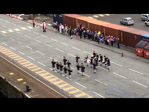 Scottish pipe and drum band on dock Greenock, Scotland - Sep 1, 2014