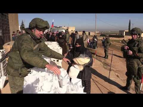 Russian military police deliver humanitarian aid in Syria's Dali Fa'r
