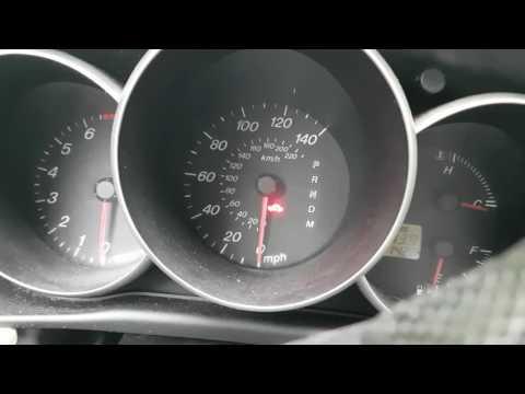Simbolo AT en un auto q puede ser ?