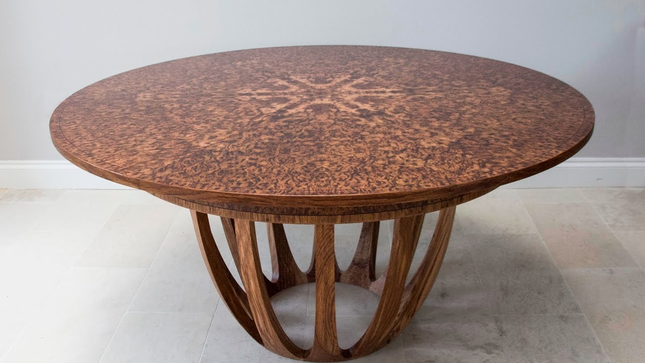 Expanding circular dining table in brown oak burr