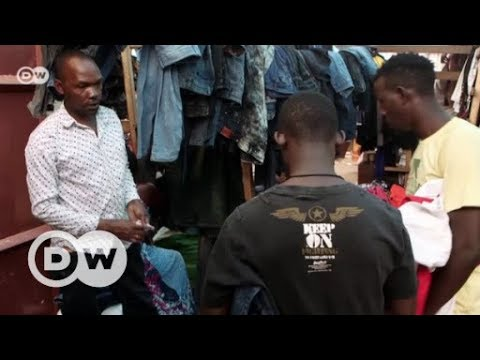 Ugandan traders uncertain about ban on used clothes | DW English