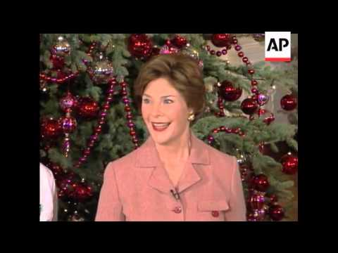 First Lady Laura Bush gives shows off the White House holiday decorations.