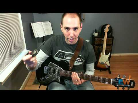 Guitar string sounds out of tune with itself: SOLVED!