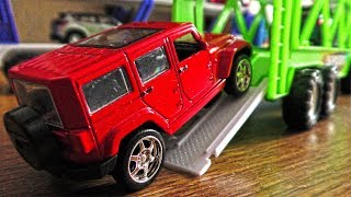 Transportation Vehicles Bringing Metal Toy Cars in One Location