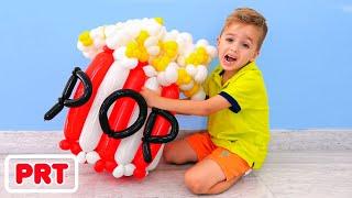 Vlad e Nikita fazem brinquedos com balões e se divertem com a mãe