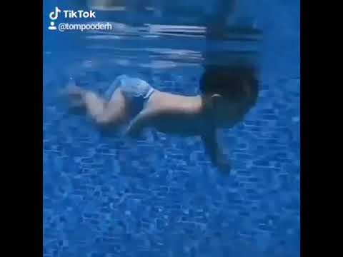 Download Newly born baby swimming 2 mins in water