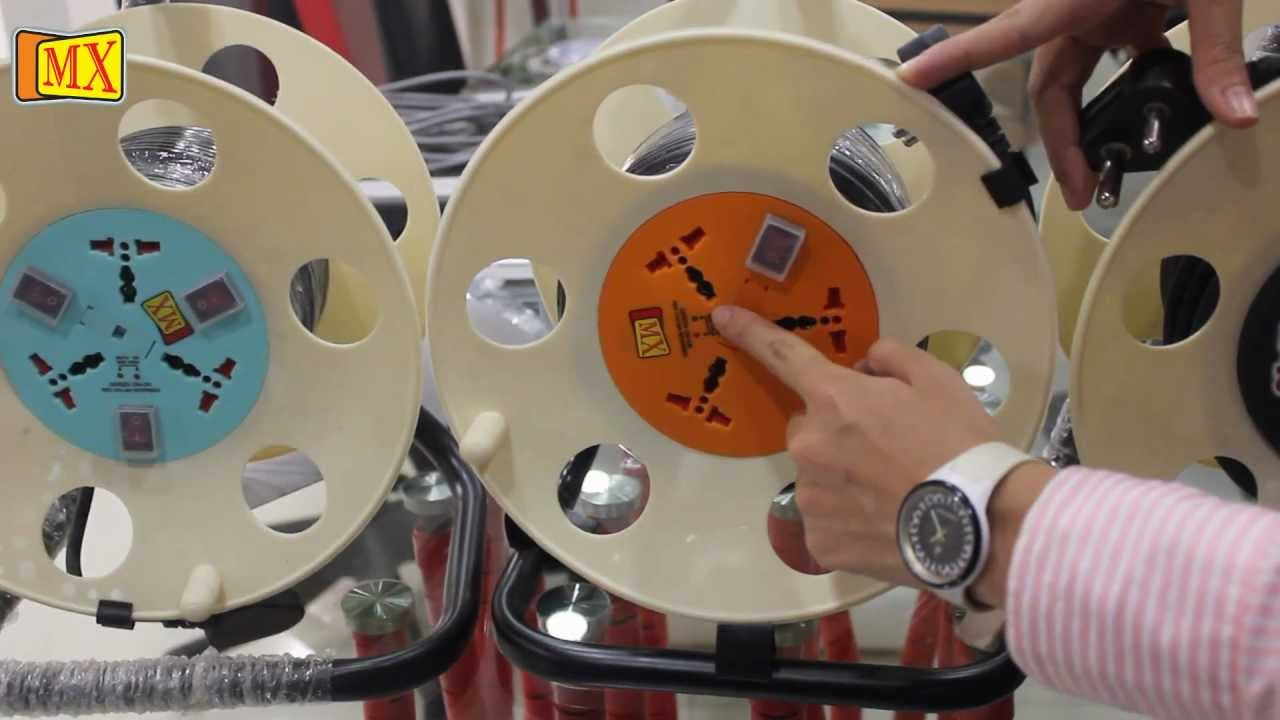 Power cable extension reel with universal sockets surge