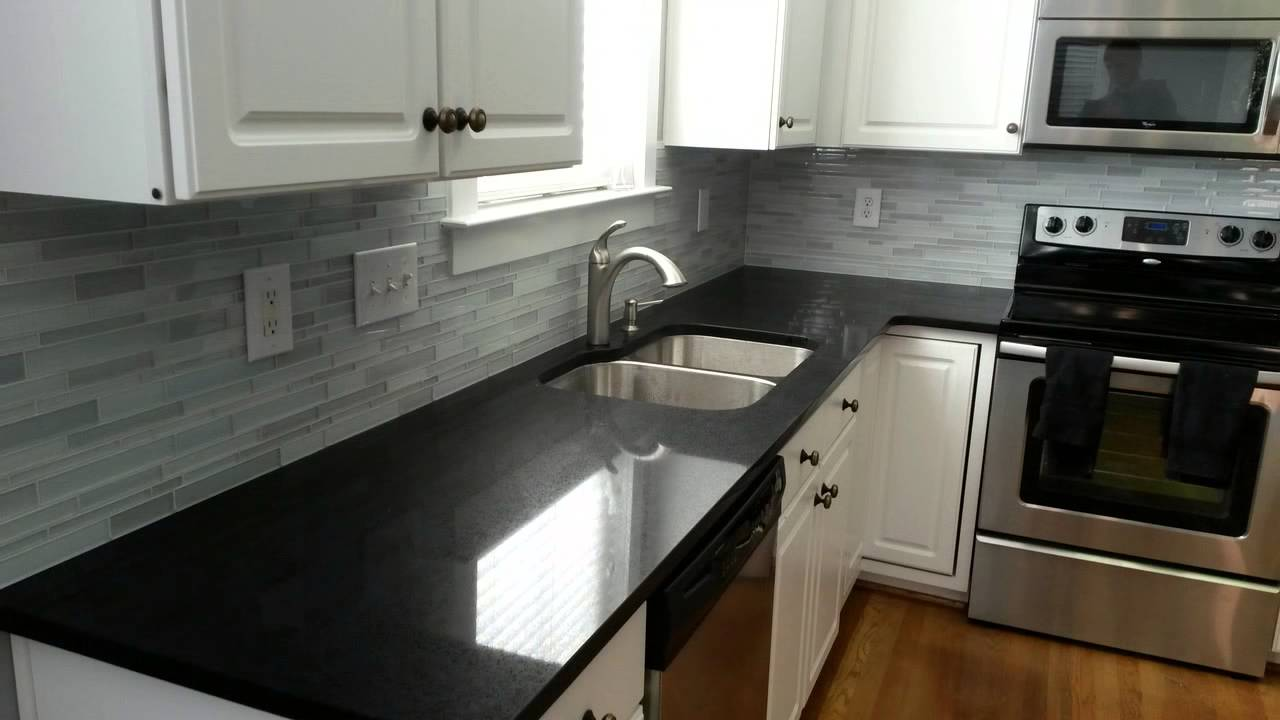 White kitchen cabinets with black quartz countertops Kitchen design black countertops