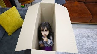 My little sister hiding in the box