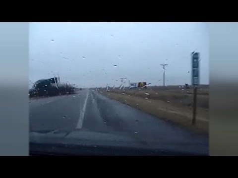Trooper Narrowly Misses Getting Hit By Truck On Icy Highway