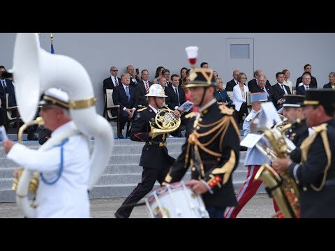 French military band plays Daft Punk medley, Trump looks bemused