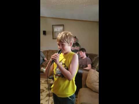Brendan sings Ring of Fire Johnny Cash karaoke.