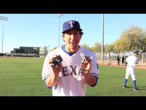 Texas Rangers pitcher Derek Holland opens packs of Topps Baseball