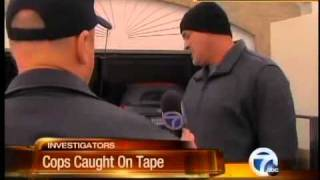MI - Cops Charged After Being Caught On Tape In Botched Pot Raid (March, 2011)