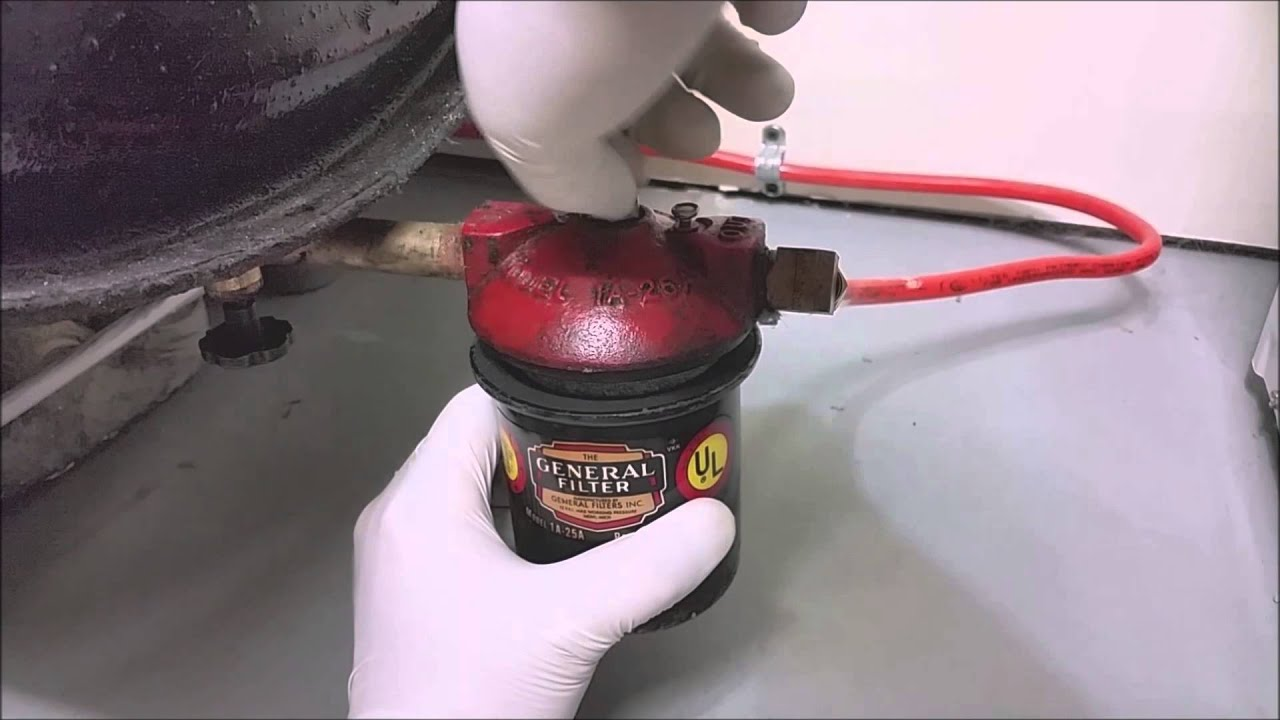 how to replace an oil filter for your oil fired boiler or furnace [ 1280 x 720 Pixel ]