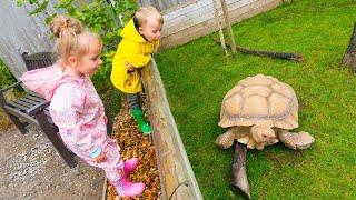Gaby and Alex feeding animals on the Farm