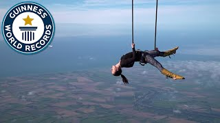 Trapeze act from hot air balloon! - Guinness World Records