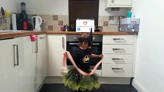 Dad and Daughter Dance in Kitchen Wearing Superhero Costumes - 1033769