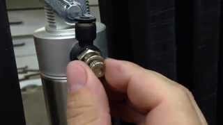 Adjusting pneumatic cylinder flow control fittings.