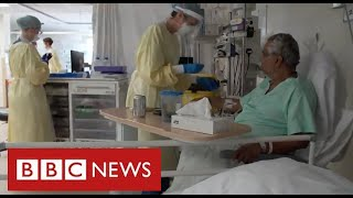 Hospitals under pressure again as Covid admissions rise sharply - BBC News