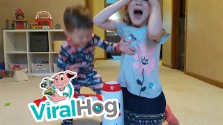 Taking Turns with the Pitching Toy || ViralHog
