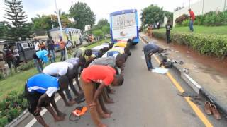 LASU students praying in front of Lagos state office - Sodiq Adelakun