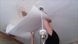 Applying Insulating Lining Paper To Ceiling