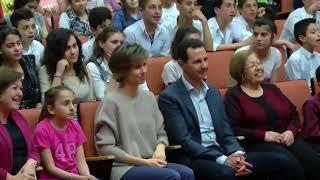 Башар и Асма аль-Асад в школе у детей погибших солдат