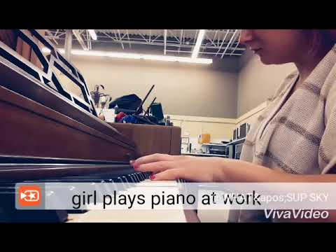 Sky blue playing on the piano at work