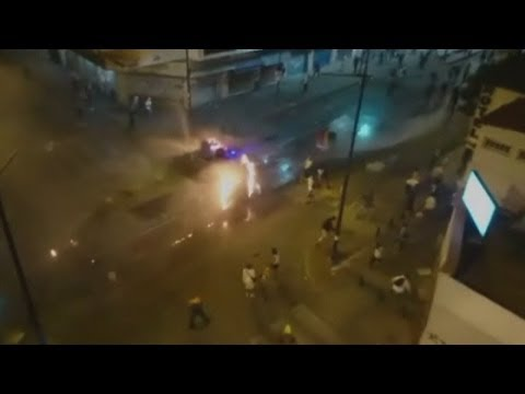 Venezuela violence: Protesters set fire to police water cannon in Caracas