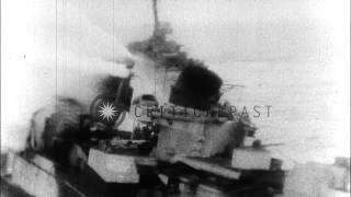 Landing Craft Infantry (LCIs) underway as 20mm gun crew aboard LCI fires at a isl...HD Stock Footage
