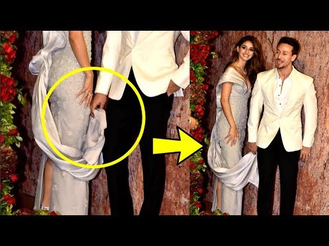 Tiger Shroff Holding  Disha Patani Dress At Deepika Padukone And Ranveer Singh Wedding Reception thumbnail