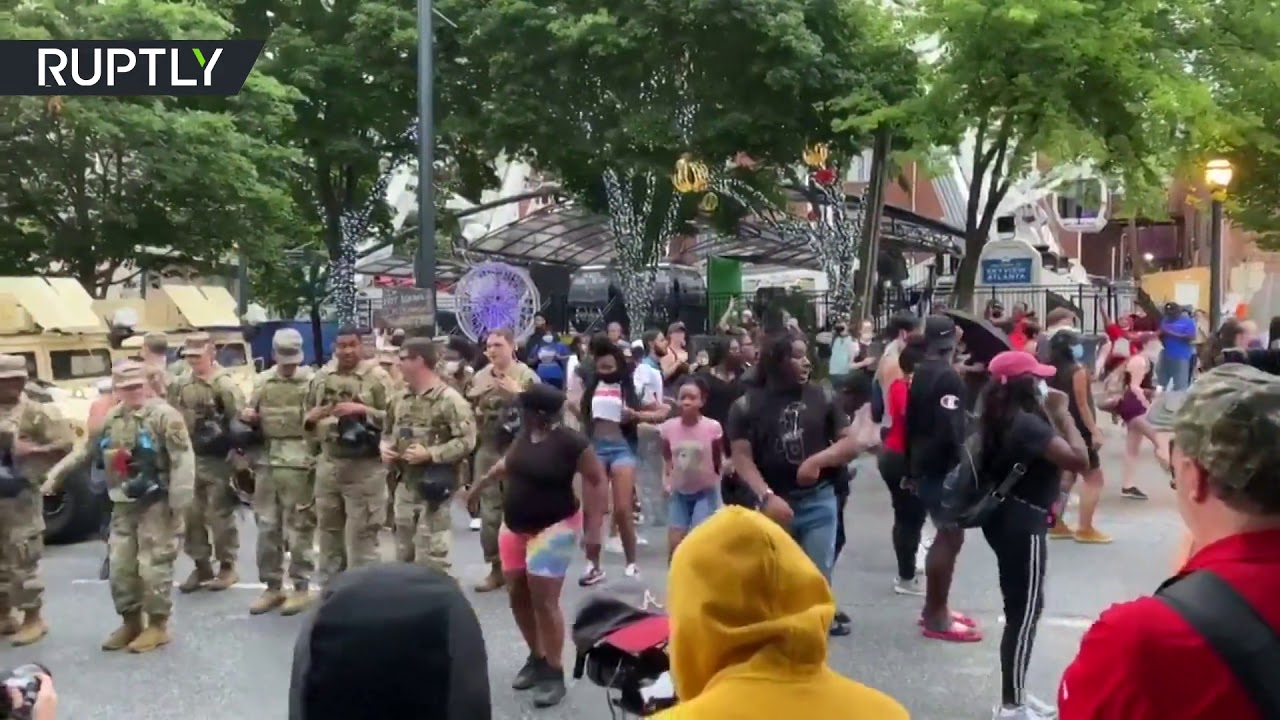 National Guard troops & protesters dance together in Atlanta