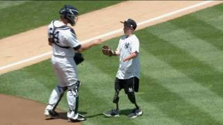 Landis Sims throws out the first pitch at Yankee Stadium