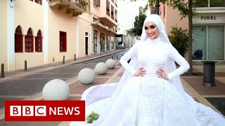 Beirut: The bride being photographed in wedding dress as blast hit - BBC News