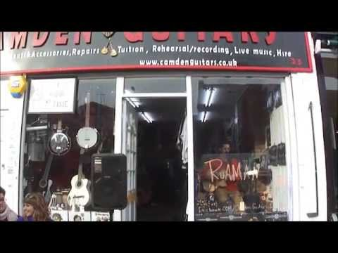"Singer ""Roaman"" performing ""Younger Now"" in the shop window of Camden Guitars, Chalk Farm Road"