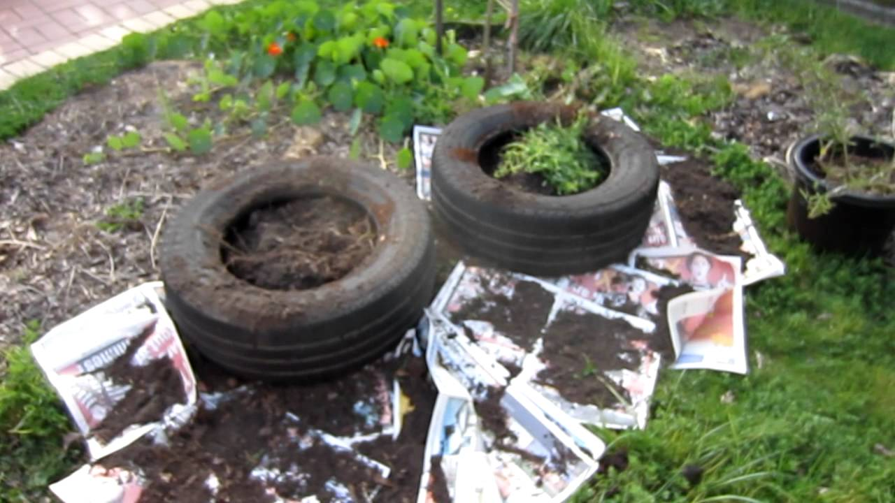 Car tire garden bed youtube for How to make a tire garden